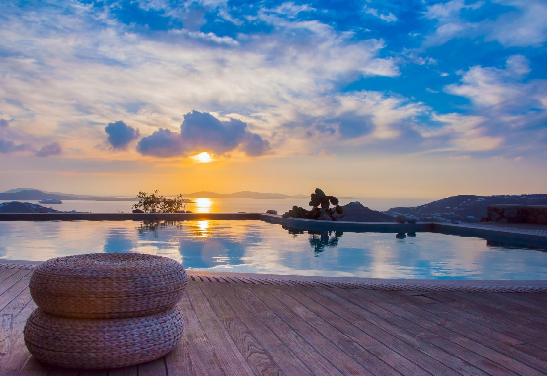 'The reflection of the beautiful clouds in the pool at sunset and the island ... Greece.' - Santorin