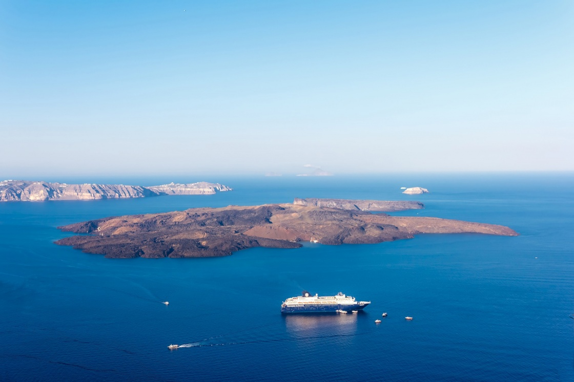 'Nea Kameni volcanic island in Santorini Greece with ships in front photographed from a high point of view' - Santorin